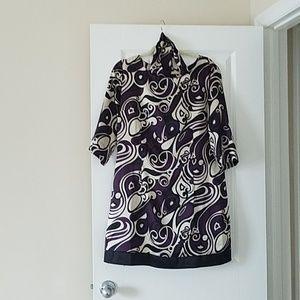 Gently worn tunic with sash.